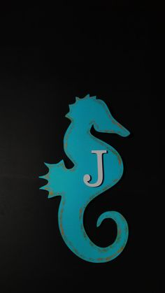 Check out this item in my Etsy shop https://www.etsy.com/listing/265607809/painted-seahorse-with-letter-door-hanger