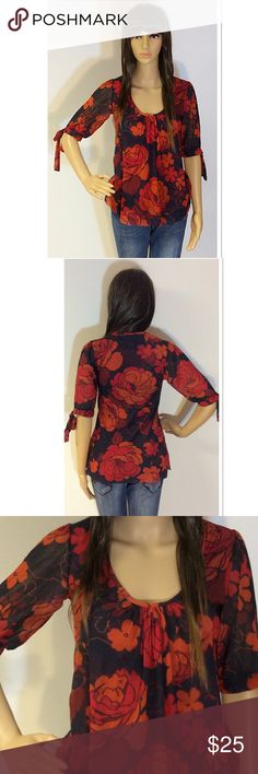 DAISY & CLOVER NYLON MESH FLORAL PRINT TOP So pretty and feminine with a tie on the sleeves. Bold, rich colors will compliment any outfit Daisy & Clover Tops Blouses