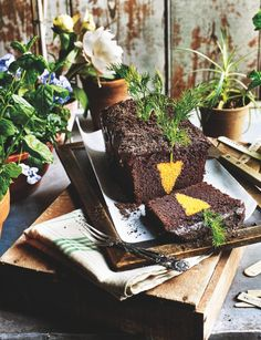 Slice into this dense and fudgey chocolate loaf cake with Oreo soil to reveal a hidden carrot!