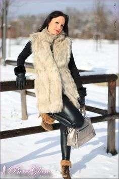 Faux fur vest with black Armani leggings and black wolford sweater