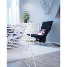 Swivel k chair in the living room. Interior design inspiration. Nordic and Scandinavian style.
