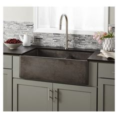 This concrete farmhouse sink not only looks good, but is hard-working, with two deep bowls and simple maintenance. And versatile to boot. Install as apron front or behind the counter.