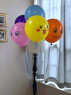Pokémon balloons as décor for a Pokémon-themed birthday party. Click or visit FabEveryday.com to see details and DIY instructions for a Pokémon or Pokémon Go themed kid's party, including printables, food, decorations, favors, and party activities.