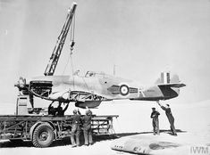 """uss-edsall:  """" Personnel of No. 53 Repair and Salvage Unit use a Coles Crane to haul the fuselage of damaged Hawker Hurricane Mark IIB, BD930 'R', of No. 73 Squadron RAF onto a 'Queen Mary' trailer in the Western Desert. Following repair, BD930 saw..."""
