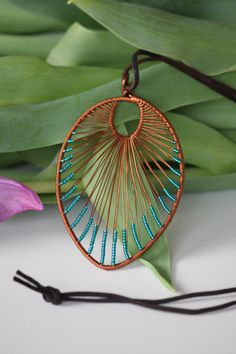 Leaf shaped copper wire wrapped turquoise by DeaJewelryStore
