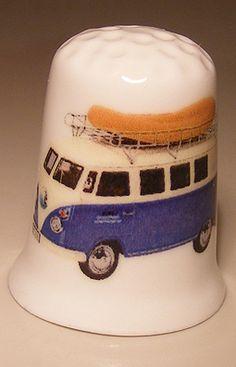 Volkswagen T1 combi Bus with dinghy porcelain thimble These are for sale by https://www.speelgoedenverzamelshop.nl/vingerhoedjes/vervoersmiddelen/volkswagen_t1_bus_met_rubberboot_op_porselein_vingerhoedje_(hmauto02).html