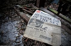 A copy of a fading newspaper lays abandoned on the floor of the mill recounts the tale of a British girl whose lover was swept overboard
