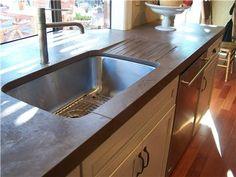 Concrete countertop.  Drainboard.