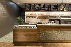 located in the gerber shopping center, the café invites shoppers to enjoy various organic and local products in a cosy, welcoming setting.