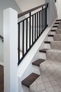 Haus-design Wood and iron staircase is lined with a gray Moroccan tiles stair runner. stairs gray hausdesign iron lined moroccan runner stair stair railing ideas Staircase Tiles Wood Stairs Trim, Tile Stairs, Staircase Railings, Staircase Design, Staircase Ideas, Banisters, Hallway Ideas, Staircase Runner, Black Stairs
