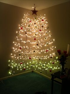 My friends Christmas tree. String lights from wall to wall in a corner using command strips. So clever!