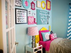 Modern meets frills in this playful, contemporary girl's bedroom with bright, bold shades of blue, pink and yellow and a mix of textures and patterns.