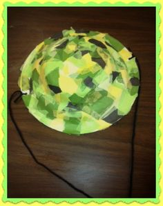 CRAFT: Safari hat! Decorate plastic safari hat - punch hole and attach yarn for string.