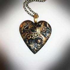 "Steampunk Pendant - Clockwork Heart Epoch - Polymer clay and vintage watch parts make up this lovely heart, in shimmering shades of copper and antique gold. On a bronze-tone chain 18"" - 20"" Size - 4cm x 4cm. Price - £18.99 - Now SOLD."