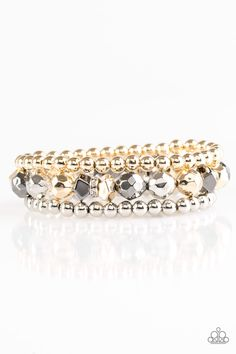 Infused with two strands of classic silver and gold beads, faceted silver, gold, and gunmetal beads and white rhinestone encrusted rings are threaded along an elastic stretchy band for a refined look. Sold as one set of three bracelets.