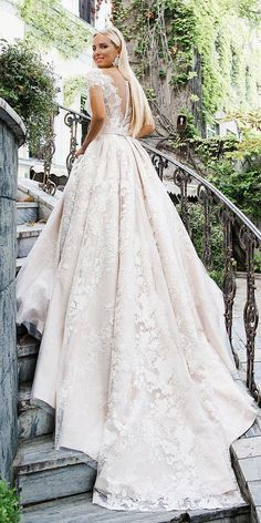 Top 24 Wedding Dresses For Celebration ❤ wedding ideas part 2 a line with cap sleeves buttons illusion back tatto effect oksana mukha ❤ See more: http://www.weddingforward.com/wedding-ideas-part-2/ #weddingforward #wedding #bride