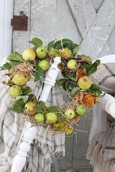 Beautiful, natural wreath of green apples, fall leaves, and straw.