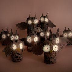 Cork owls with glow in the dark eyes. I saw these and at first thought they were chunks of wood instead of cork. Like the wood idea.