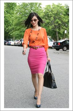 Beautiful orange blouse is paired with a gorgeous hot pink pencil skirt.