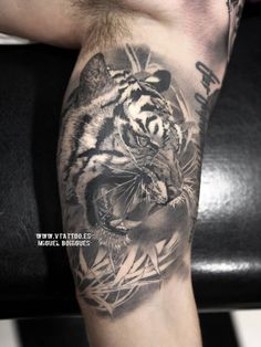 Black and grey style tiger tattoo on the left inner arm. By Miguel Ángel Bohigues (Valencia, Spain).