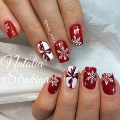 Love these nails for Christmas! Love the red color and the designs. The snowflakes and ribbon designs are gorg! #nails #christmasnails #snowflakes #ribbons