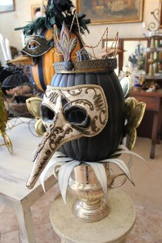 Fabulous pumpkin with mask - I would pin this 100 times over.  I simply LOVE this!