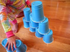 Try using a set of plastic cups for a little block play...