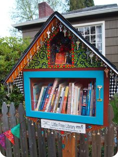 "A well-dressed, pretty little free library! ""Reading is the Key to Imagination!"" <3 it!"