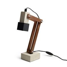 The trendy and unique desk lamp is designed by the well-known Swedish designer Tove Adman, known for her interior products in concrete. This desk lamp is made of concrete, walnut and black textile and has a cool industrial look, equipped with a black textile cord and switch. The lamp looks great on your desk and is easy to match with other trendy items from Tove Adman!