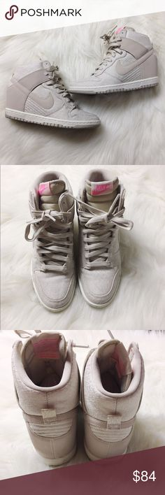 Nike Dunk Sky Hi Sneakers Nike's Women Dunk Sky High Top Sneakers. Gray white & pink combo. Worn a handful of times, great condition. Main wear is on the bottom sole. Size 7. Comes with original box. No modeling/trades. Nike Shoes Sneakers