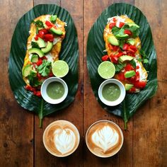 Cachapas topped with mozzarella, tomato, avocado, coriander leaf and jalapeño hot sauce and a cafe latte