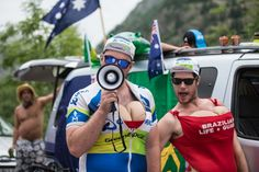 A couple of randy Orica fans get the party going in their corner of the Alpe. Photo: BrakeThrough Media | VeloNews.com