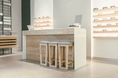 The interior design is a luxed up extrapolation of the original niche nation store without ditching its inviting atmosphere. Behind an expansive glass façade sleek floor-to-ceiling metal grids not only add a sophisticated visual layer but also incorporate a number of light wooden display boxes.