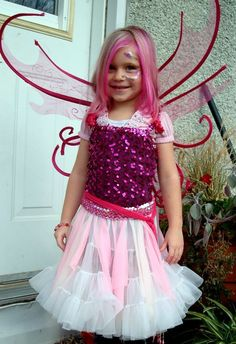 Fairy Sorcha age 5.  This was a super easy Halloween costume for a little girl.  It was just regular clothes she already had. We just bought the wings.  Some temporary hair dye and a little bit of glitter makeup.  This was when pink was the only colour!