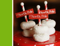 North Pole doughnuts on a plate. Cute & easy christmas party treat! Holly Jolly Party via www.karaspartyideas.com