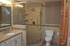 Beautiful and elegant bathroom remodel with walk-in shower and white vanity by South Valley Remodeling in New Berlin, Wisconsin