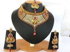 Traditional Costume Fashion Jewelry with clear and Ruby stones Polki set -03PLKM11  http://www.craftandjewel.com/servlet/the-1824/Traditional-Costume-Fashion-Jewelry/Detail