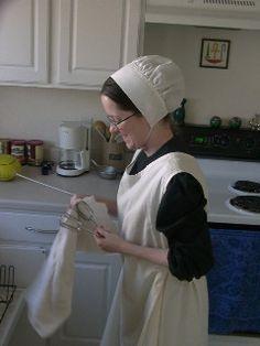 Quaker Jane in baking cap and apron