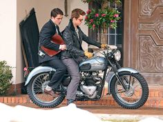 Hold on tight! Robert Pattinson takes a back seat while filming a motorcycle scene with costar Dane DeHaan for their new film Life in Toronto. http://www.people.com/people/gallery/0,,20795873,00.html#30118304