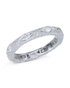 40ad51b64ae08 18 karat white gold ring with an engraved design set with 106 round  diamonds and 8