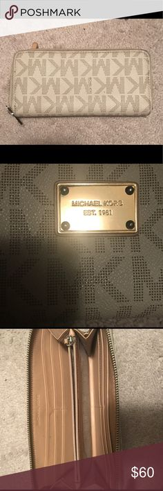 🎉MICHAEL KORS Wallet 🎉 MICHAEL KORS zip up wallet!! This cream wallet is in very good pre loved condition. Gold plate has seen some wear and leather has the slightest fade due to use. Please reference picture & happy to post additional! Michael Kors Bags Wallets