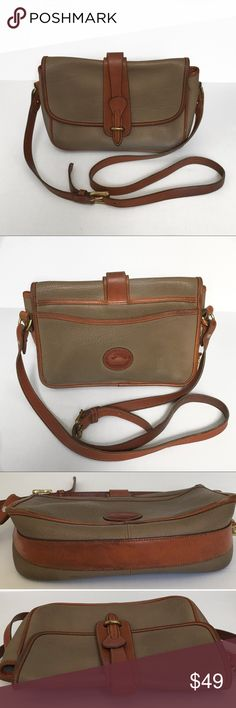 """Vintage Dooney & Bourke Leather Crossbody Purse Vintage Dooney & Bourke leather crossbody bag purse. Tan and brown all weather leather and pebble grain leather. Magnetic flap closure with inner zippered pocket and card slots. Adjustable and removable crossbody strap. Includes inner red, white, and blue tag and brass duck charm. Bag is vintage and preloved. Shows signs of wear and use, including pen marks, a marker marking on inside, and other cosmetic/wear imperfections. Approximately 10""""…"""