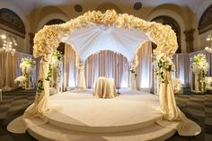 This textured canopy wrapped with vines is a simple yet stunning choice...Enchanting Ceremony Setups**