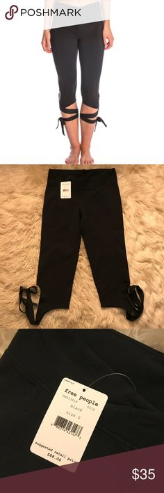 Free People Turnout Yoga Capri Leggings S Free People  Turnout Yoga Capri Leggings. Black size Small Cute tie style.  NWT Brand New with tags No Flaws Free People Pants Leggings
