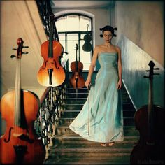 Violinist. Music is known for no boundaries, so is levitation. (Image Source: Anka Zhuravleva)