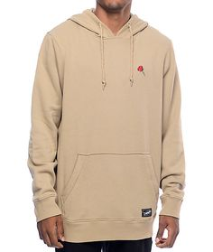 Get comfortable style with the Baseline pullover hoodie in khaki from Empyre that has a soft fleece lining for warmth and is adorned with red and green rose embroidery at the left chest for style.