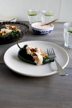 Grilled Poblano Peppers with Chorizo, Chicken and Chipotle Cream. Save on this recipe! Take the Queso IQ Challenge and claim your coupon for new Cacique Shredded Cheese. (Two Ingredients Queso) Spicy Recipes, Gourmet Recipes, Mexican Food Recipes, Cooking Recipes, Healthy Recipes, Spanish Recipes, Fast Healthy Meals, Stuffed Poblano Peppers, Baked Apples