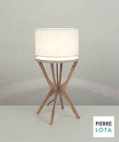 Lamp from wooden hangers, from Pierre Lota