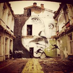 . Another wall by French artist Mouarf.
