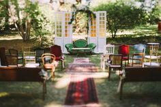 vintage ceremony decor of mismatched chairs and sofas